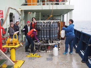 Leg 2 VISIONS students  on deck of the Atlantis enjoying the art of water sampling. Credit: Orest Kawka, University of Washington; V19.
