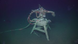 A rear view of the anemones, barnacles, and tunicates covering the Oregon Shelf digital camera after a one year deployment. A lingcod fish is hanging out beneath the tripod, and a large number of ctenophores (comb jellies) were also seen at the site. Photo Credit: UW/NSF-OOI/WHOI, V19