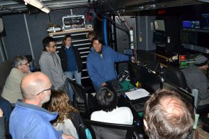 Katie Gonzalez helping to train the new Leg 3 personnel on the use of the logging stations in the Jason control van. Credit: M. Elend, University of Washington, V19