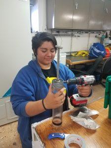 Katie Gonzalez helps put push core samplers together for Yvan Alleau and Jenny Delaney. Photo credit: Jennifer Delaney, Harvard, V19