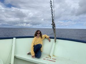 Recent UW graduate and new employee Rachel Scott on the bow of the R/V Atlantis during another beautiful day on the VISIONS '19 OOI cruise. Credit: R. Scott, V19