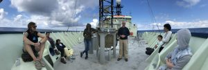 A beautiful day at Slope Base (2900m) was a good opportunity for an outdoor class on science careers for the VISIONS'19 students on the bow of the R/V Atlantis. Credit: M. Vardaro, University of Washington, V19