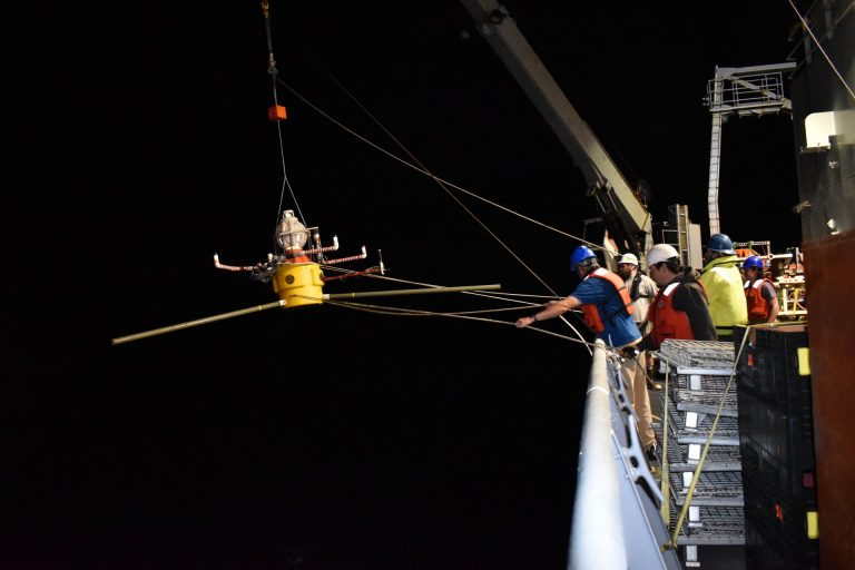 A HPIES instrument is about to be released to free fall to the seafloor 2600 m below at the base of Axial Seamount. Credit: University of Washington.