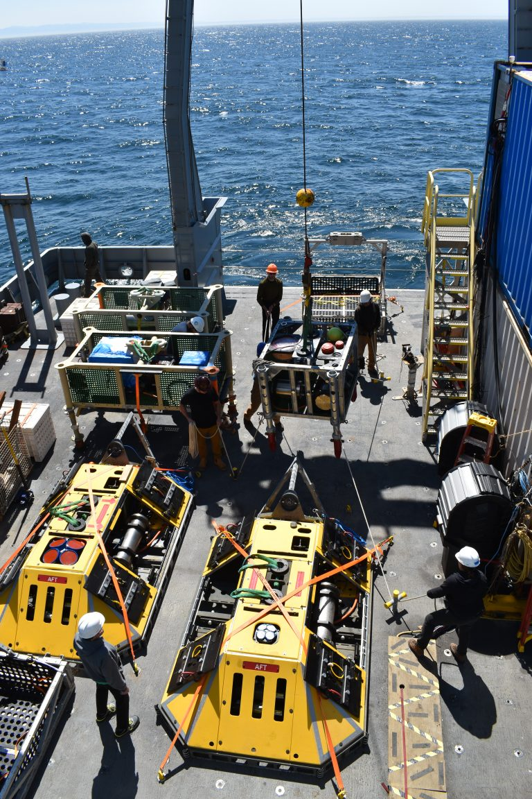 The fantail of the R/V Thompson is loaded with BEP's. junction boxes, and a sonar on Leg 2 of VISIONS20. Credit: M. Elend, University of Washington. V20