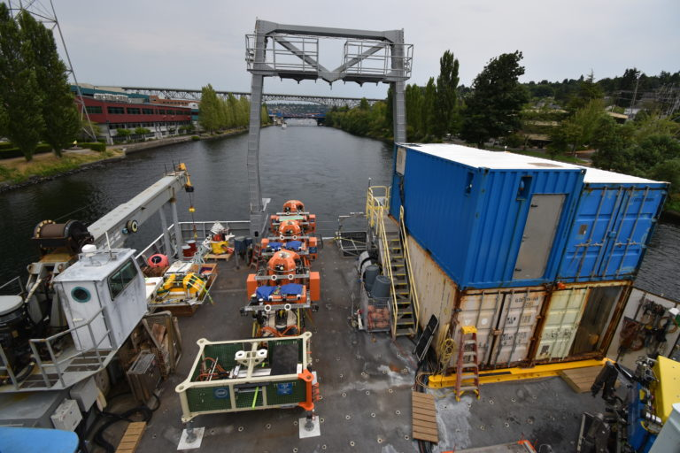 The fantail of the R/V Thompson is loaded with instrumentation to be deployed on Leg 1 of the RCA 2021 expedition as the ship heads south the ship canal to the Ballard Locks. Credit: M. Elend, University of Washington, V21.