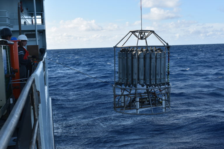 The CTD rosette is launched off of the R/V Thompson at the Axial Base site. Credit: M. Elend, University of Washington. V21.