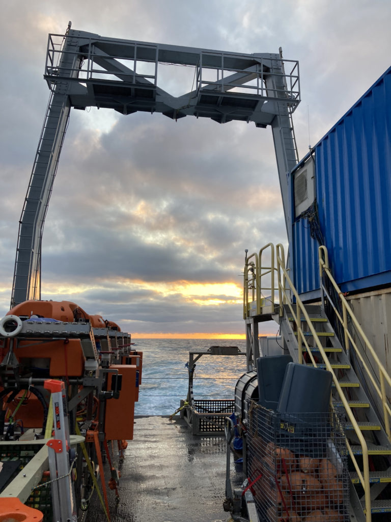 A beautiful sunrise greets the students onboard the R/V Thompson as she steams towards Axial Base.  Credit: C. Fink, University of Washington, V21