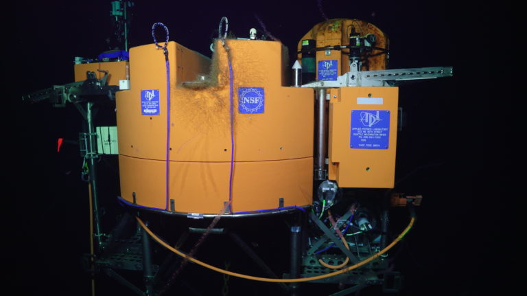 The Shallow Profiler Mooring platform, hosting the instrumented Platform Interface Assembly (left) and winched science pod (right) - both have been in the water since last year. Credit: UW/NSF-OOI/WHOI; V21.