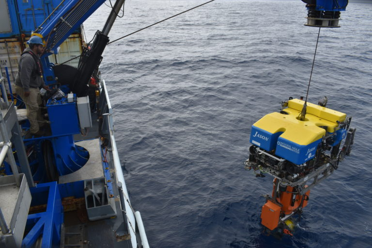 The science pod, for the Shallow Profiler Mooring at Axial Base, is latched beneath Jason for installation on the 200 m deep platform. Credit: M. Elend, University of Washington, V21.