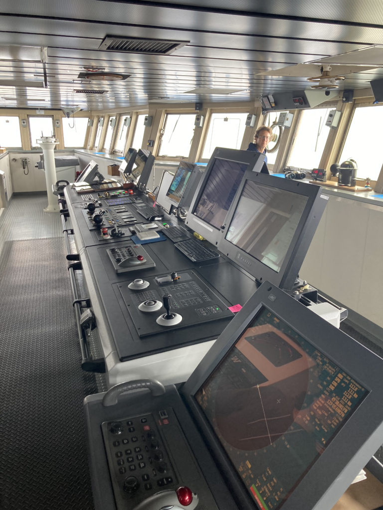 The bridge onboard the thompson showing the windows and technologies that the  Captain uses to operate the ship. Credit: C. Fink, University of Washington, V21.