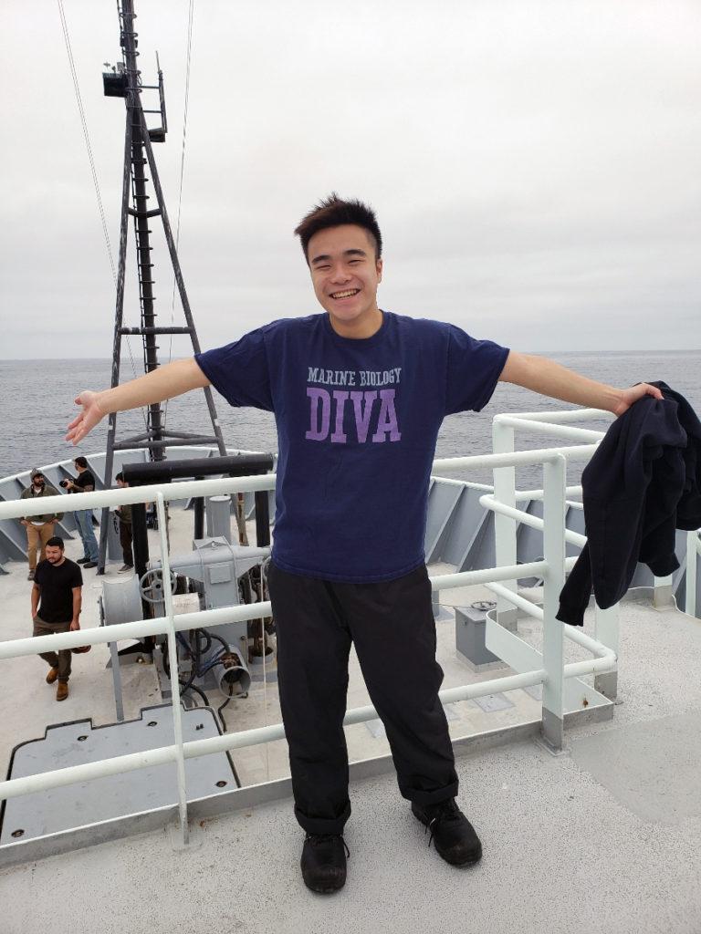 Kenneth Lai enjoys fresh ocean air aboard the R/V Thompson. Credit: E. Littell, University of Washington, V21.