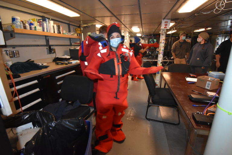 At safety training, Jazmine races to put on her immersion suit. Credit: M. Elend, University of Washington, V21.
