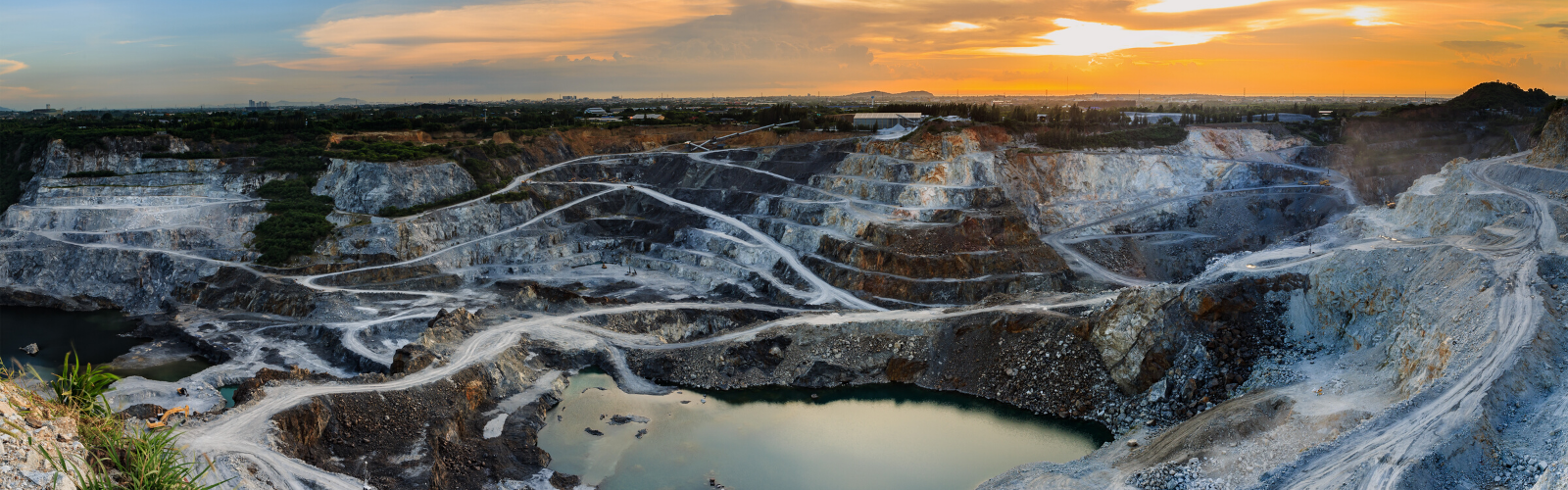 Ariel view of a Cobalt or Mica mine nestled in the mountains at sunset.