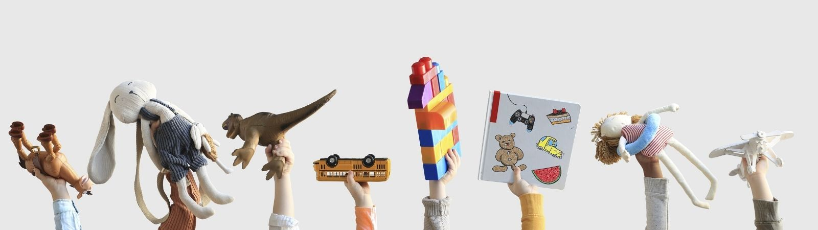 Eight children's hands holding up various toys including stuffed animals, blocks, trucks, and books on a white background.