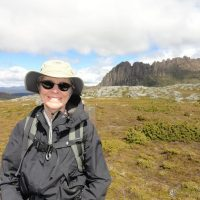 Cathy Whitlock with Cradle Mountain in the background