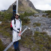 Gabe Yospin stands at the ready Cradle Mountain in the background