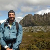 Gabe Yospin Wildfire PIR Epostdoc stands in front of Cradle Mountain