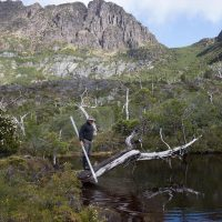Simon Haberle at a small tarn below Cradle Mountain