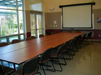 Tables arranged in a boardroom configuration.
