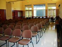 Rows of chairs in Sakuma Auditorium, windows at rear..
