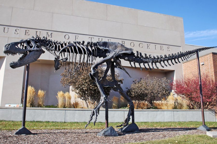 A full view of bronze T. rex sculpture Big Mike located in front of the museum.