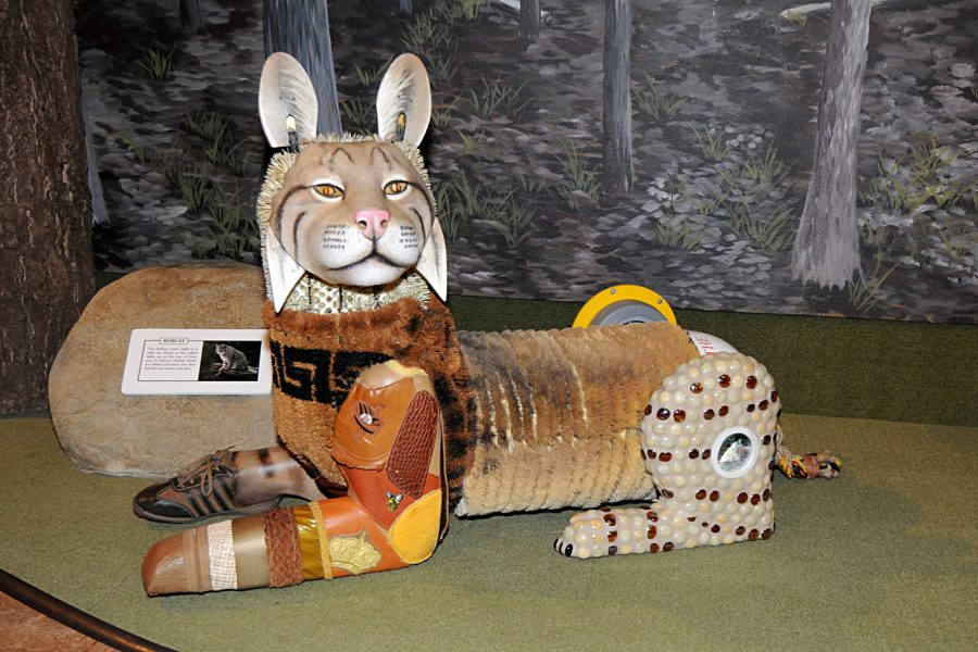 A hand-made Bobcat made from recycled materials.