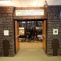 A replica Roosevelt Arch welcomes you to Explore Yellowstone.
