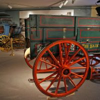 The horse-drawn Bain Wagon and a horse-drawn carriage.