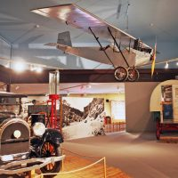 Historic automobiles, wagons, and a plane are on display on the Paugh History Hall.