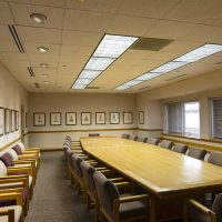 The Janke Board Room with a large conference table and numerous chairs around it.