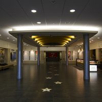 The Bair Lobby with a view of the front desk and changing exhibition gallery.