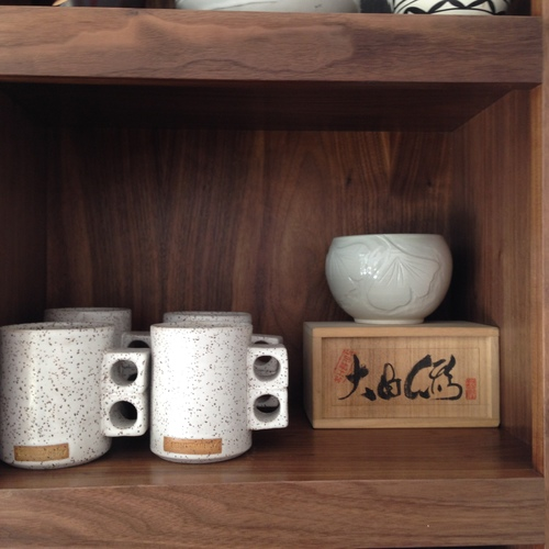 Tea cups   in custom cabinets