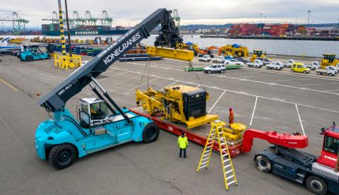Reach stacker lifting cargo at a breakbulk terminal.