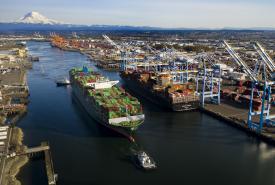 A tug pulling a big ship