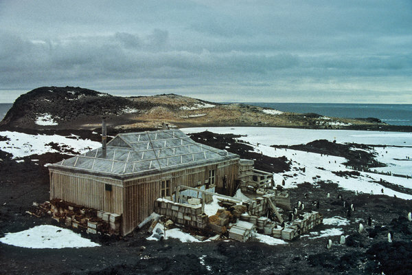 Shackleton's Hut, inspected by Adelie penguins, in 1981. Because of the Antarctic's punishing conditions, permanent bases there need constant attention and repair.