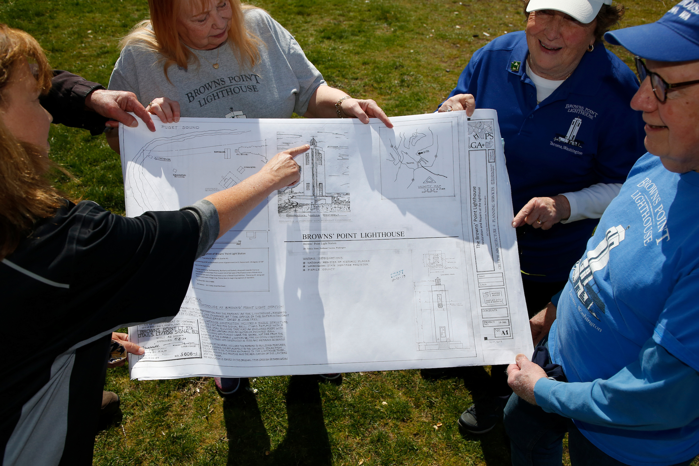 photo of man and women holding a blueprint