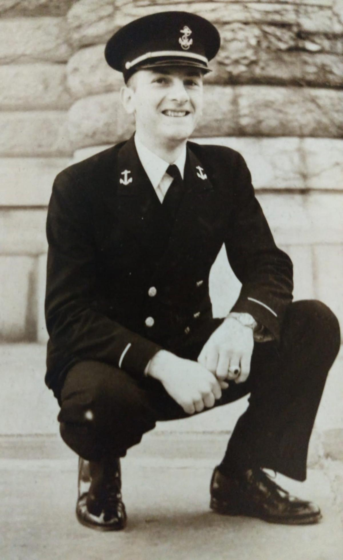 photo of a man in military uniform kneeling