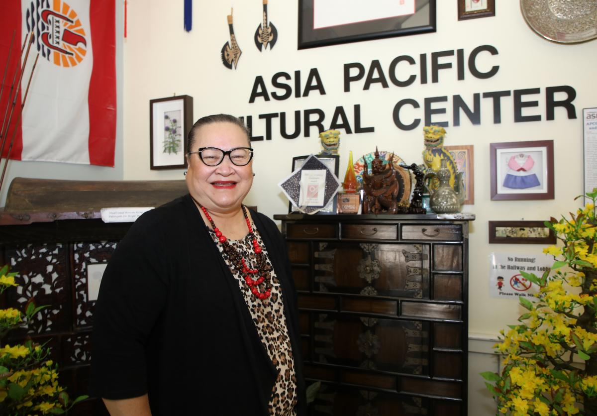 photo of a woman standing in front of a wall reading Asia Pacific Cultural Center