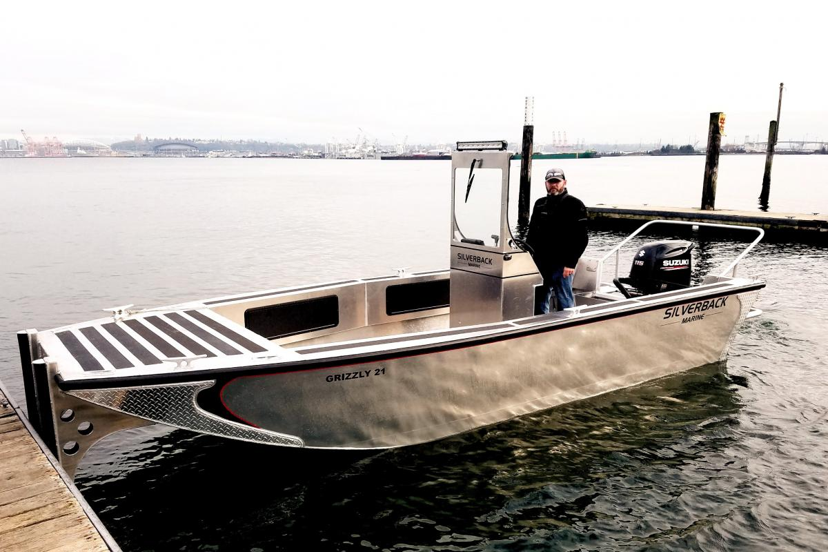 photo of a man in aluminum boat