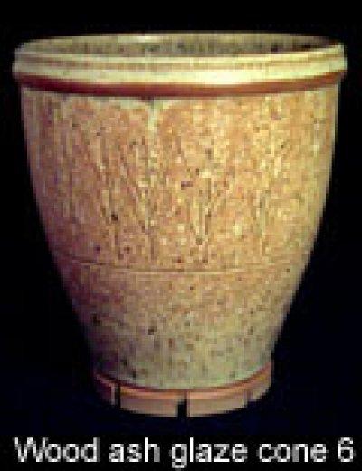A cone 6 wood ash glazed planter