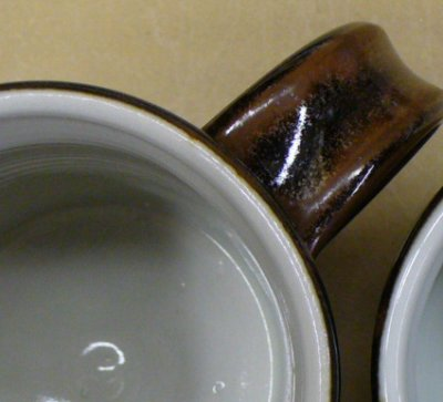 Outside tenmoku glaze meets inside transparent in a straight line at the rim