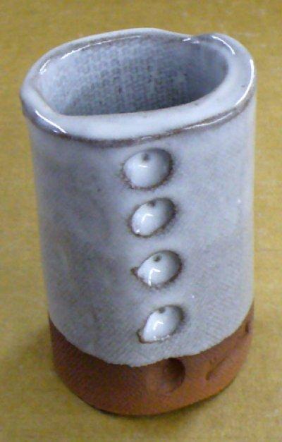 5% tin oxide in a transparent boron cone 6 glaze