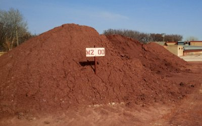 Raw red burning clay stockpile