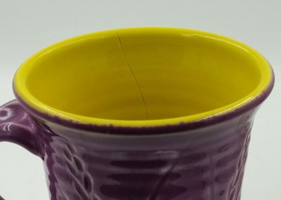 Yellow stain has decreased the thermal expansion of the base glaze
