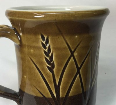 Pinholing at a cone 6 stoneware mug. Why?
