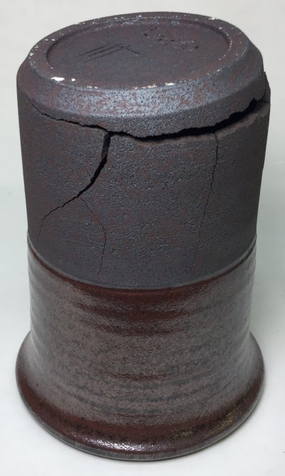 A vessel being forced apart by the pressure of a low expansion glaze inside