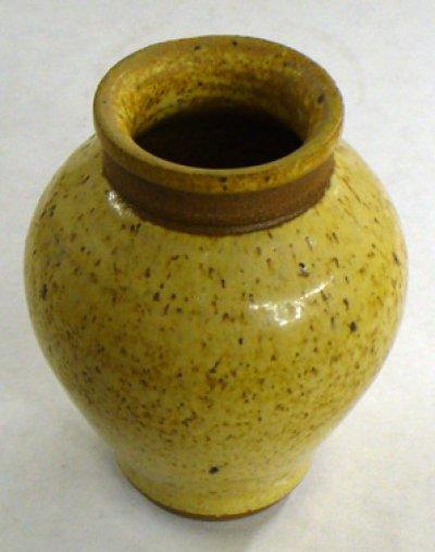 A small wood ash glazed cone 6 vase
