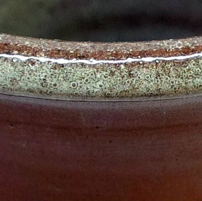 Red burning clays bubble glazes more