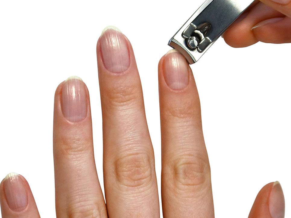 Clipping nails with JAPONESQUE® Pro Performance Nail Clippers