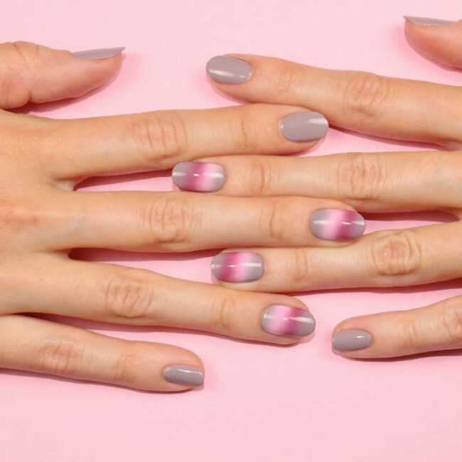 hands with multicolored nail painting